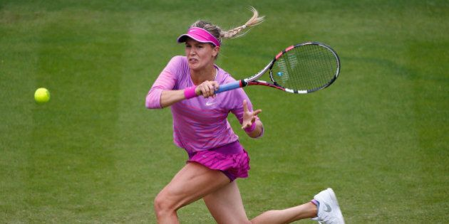 EASTBOURNE, ENGLAND - JUNE 23: Eugenie Bouchard of Canada in action against Alison Riske of USA during...