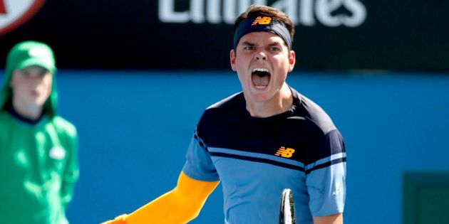 Milos Raonic of Canada celebrates after defeating Tommy Robredo of Spain in their second round match at the Australian Open tennis championships in Melbourne, Australia, Thursday, Jan. 21, 2016.(AP Photo/Vincent Thian)