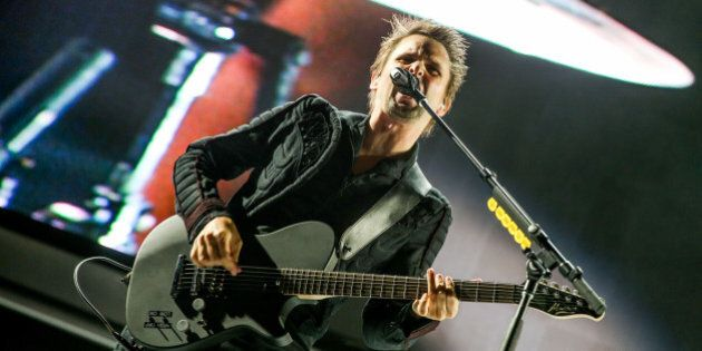 Matt Bellamy of Muse performs at the KROQ Weenie Roast at the Irvine Meadows Amphitheatre on Saturday,...