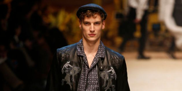A model wears a creation for men's Fall-Winter 2016-2017 collection, part of the Milan Fashion Week, unveiled in Milan, Italy, Saturday, Jan. 16, 2016. (AP Photo/Luca Bruno)