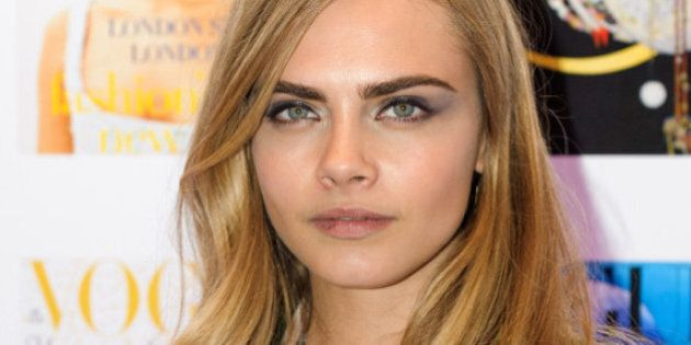 Cara Delevingne arrives at the Vogue Festival 2012 at the Royal Geographic Society, in Kensington, central