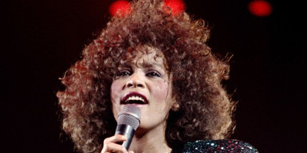 A file picture taken on May 18, 1988 in Paris shows US singer Whitney Houston performing at the POPB...
