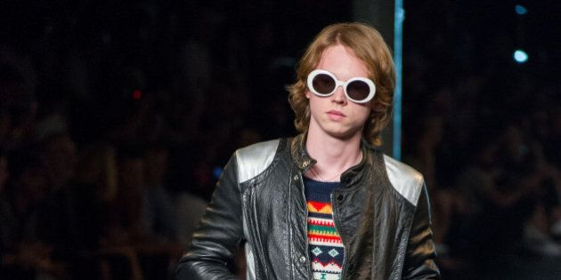 In this photo dated Sunday, June 28, 2015 Charlie Oldman, actor Gary Oldman's son, wears a creation at...