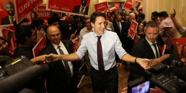 BRAMPTON, ON- AUGUST 25  -  Federal Liberal Leader Justin Trudeau greets the audience as he campaigns during the Canadian Federal Election  at the Embassy Grand Convention Centre in Brampton. August 25, 2015.        (Steve Russell/Toronto Star via Getty Images)