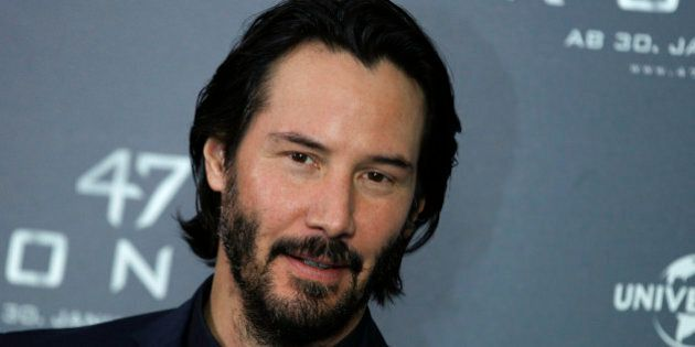 Actor Keanu Reeves poses during a photocall to promote the fantasy action film