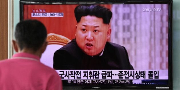 A man looks at a television screen showing an image of Kim Jong Un, leader of North Korea, during a news...