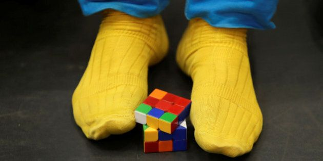 A competitor solves a Rubik's cube using his feet as he prepares for the Rubik's Cube European Championship...