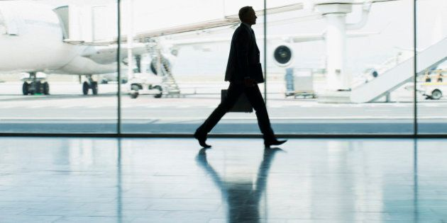 Businessman with suitcase in airport