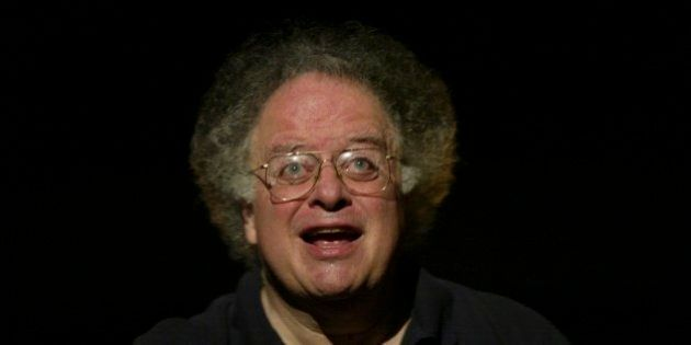 Conductor James Levine acknowledges the audience's applause during the final dress rehearsal of Gaetano