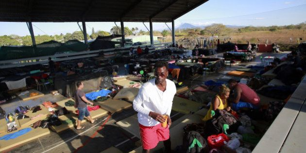 LA CRUZ, Jan. 13, 2016 -- Cuban migrants arrange their belongings at a shelter in La Cruz, Costa Rica,...