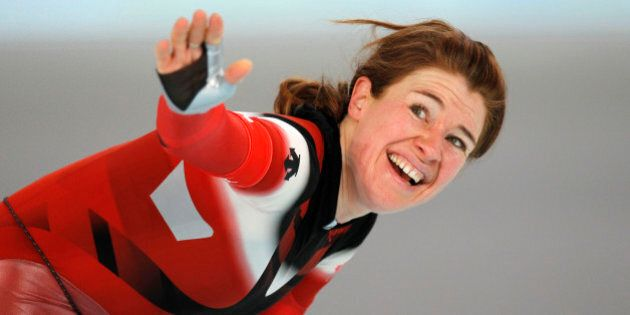 Canada's Clara Hughes reacts after the women's 5,000 meter speed skating race at the Richmond Olympic...