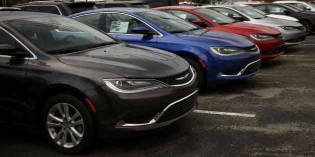 Fiat Chrysler Automobiles NV vehicles sit on display for sale at the Shelbyville Chrysler Dodge Jeep...