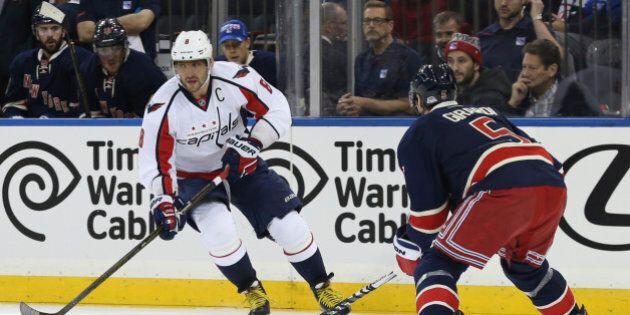Washington Capitals left wing Alex Ovechkin (8) skates against New York Rangers defenseman Dan Girardi...
