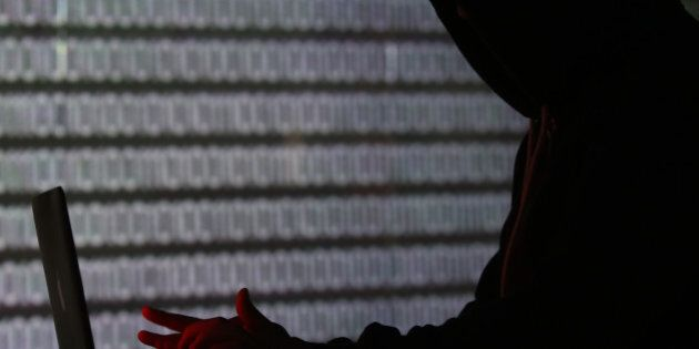 An illuminated wall displays a stream of binary coding, text or computer processor instructions, as a...