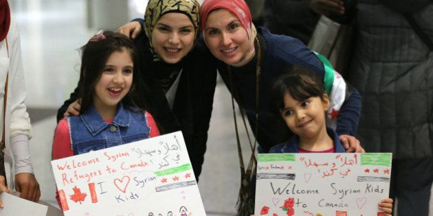 MISSISSAUGA, ON- DECEMBER 10: Maryam and Nore Kasmeih wait for Syrian refugees at the airport, their...