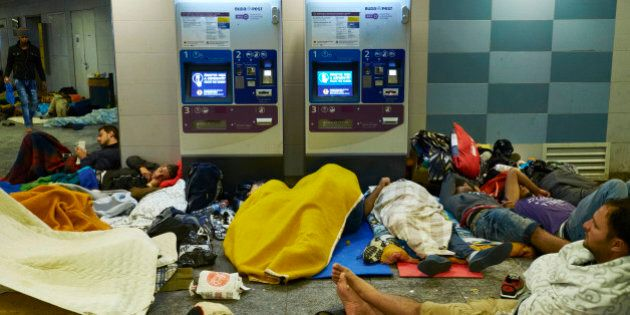 BUDAPEST, HUNGARY - SEPTEMBER 05: Migrants rest inside Keleti Station on 05 September 2015 in Budapest,...
