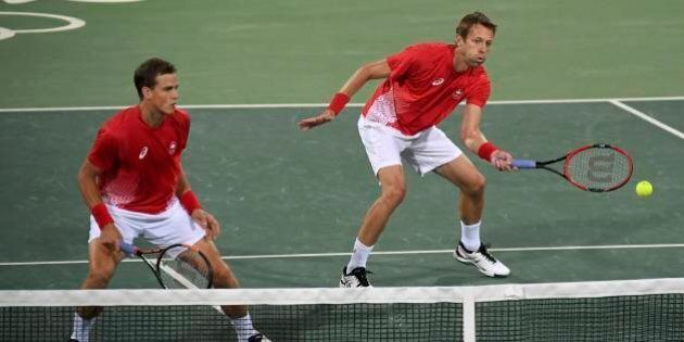 2016 Rio Olympics - Tennis - Final - Men's Doubles Bronze Medal Match - Olympic Tennis Centre - Rio de Janeiro, Brazil - 12/08/2016. Daniel Nestor (CAN) of Canada and Vasek Pospisil (CAN) of Canada react during their match against Steve Johnson (USA) of USA and Jack Sock (USA) of USA. REUTERS/Toby Melville  FOR EDITORIAL USE ONLY. NOT FOR SALE FOR MARKETING OR ADVERTISING CAMPAIGNS.