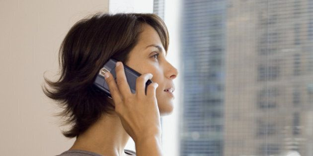 Businesswoman using cell