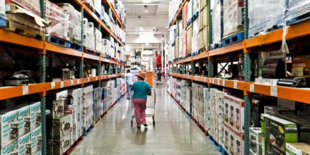 a female shopper walks the aisles of warehouse retailer COSTCO