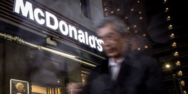 TOKYO, JAPAN - APRIL 17: A man walks past a McDonalds restaurant on April 17, 2015, in Tokyo, Japan....