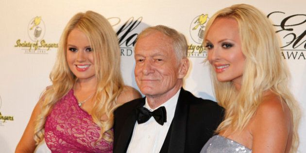 Playboy magazine founder Hugh Hefner and girlfriends Anna Sophia Berglund (L) and Shera Bechard arrive...