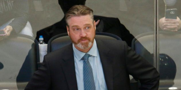 Colorado Avalanche head coach Patrick Roy looks on against the Anaheim Ducks in the first period of an...