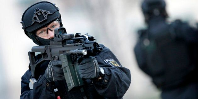 A Police officer holds a weapon during a training operation of the new BFE+ (Evidence and Arrestment) unit of the German federal police in Ahrensfelde near Berlin, Germany, Wednesday, Dec. 16, 2015. Germany on Wednesday introduced the  new police unit that officials said will be better armed, outfitted and trained to deal with terrorism, based on an analysis of the country's security in the wake of deadly attacks in Paris earlier this year.  (AP Photo/Michael Sohn)