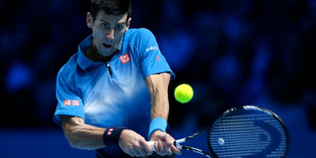 Novak Djokovic of Serbia plays a return to Roger Federer of Switzerland during their ATP World Tour Finals...