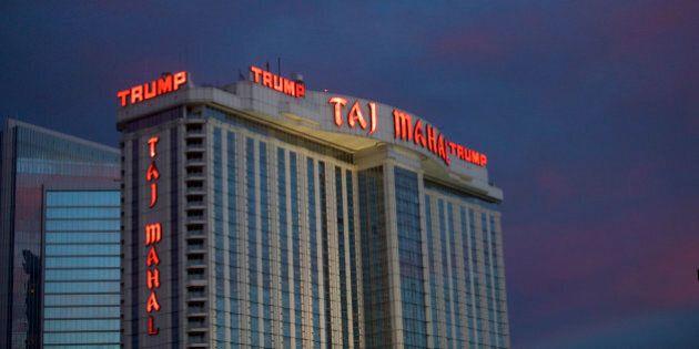 The Trump Taj Mahal Casino is illuminated at dusk in Atlantic City, New Jersey, U.S. October 24, 2014....