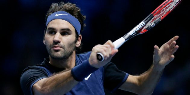 Switzerland's Roger Federer plays a return to Switzerland's Stan Wawrinka during their ATP World Tour...