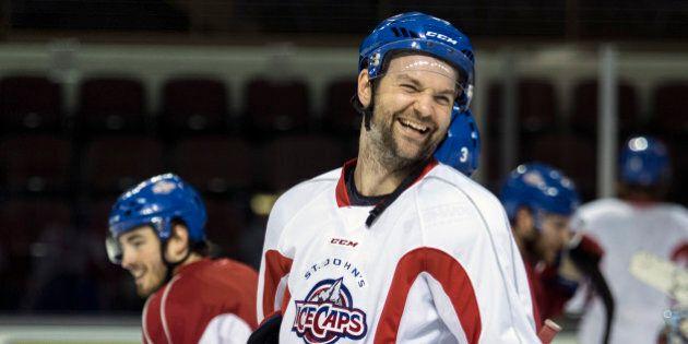 PORTLAND, ME - JANUARY 26: John Scott, (cq) a 6-foot-8 brawler type hockey player, shares a laugh with...