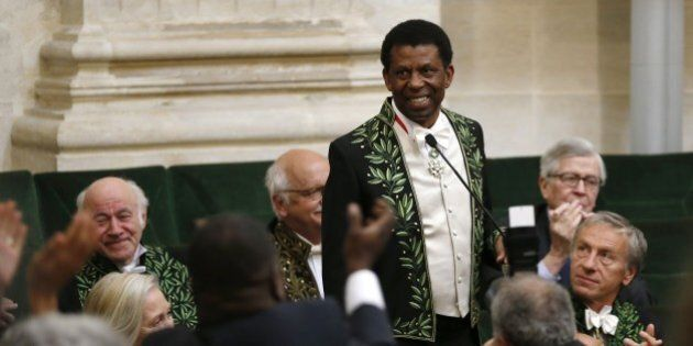 Haitian Canadian writer Dany Laferriere wearing his Academician suit, is applauded on May 28, 2015 in...