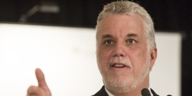 Quebec Liberal leader, Philippe Couillard(C), addresses the Board of Trade of Metropolitan Montreal April...