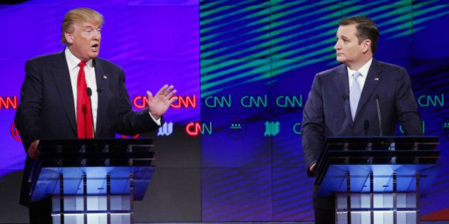 Republican presidential candidate, businessman Donald Trump, speaks as Republican presidential candidate, Sen. Ted Cruz, R-Texas, listens during a Republican presidential debate sponsored by CNN, Salem Media Group and the Washington Times at the University of Miami, Thursday, March 10, 2016, in Coral Gables, Fla. (AP Photo/Wilfredo Lee)