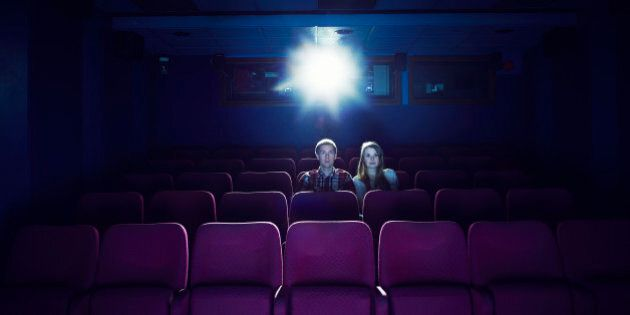 Couple watching a movie in an empty