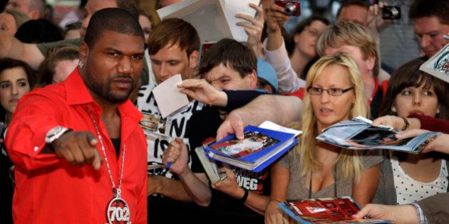US actor Quinton 'Rampage' Jackson, left, arrives for a VIP preview of the movie A-Team in Berlin, Germany,...