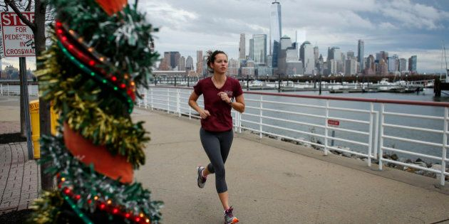 NEWPORT, NJ - DECEMBER 24: A woman jogs along the Hudson River shore on December 24, 2015 in Newport,...
