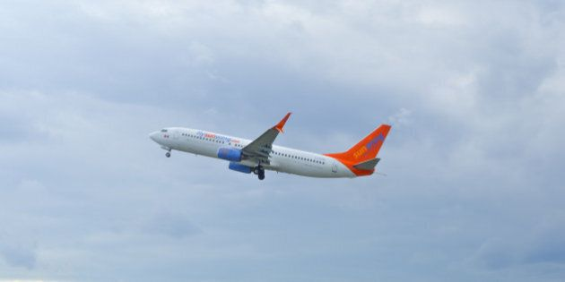 Montreal, Canada- July 3, 2016: Airplane of Sunwing above the Trudeau airport in Canada.