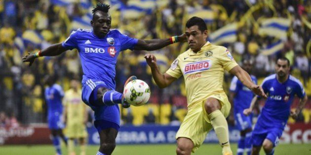 America's Miguel Zamudio (R) from Mexico vies for the ball with Dominic Oduro (L) of Montreal Impact of Canada during their CONCACAF Champions League first leg football final at the Azteca stadium in Mexico City on April 22, 2015. AFP PHOTO/RONALDO SCHEMIDT        (Photo credit should read RONALDO SCHEMIDT/AFP/Getty Images)