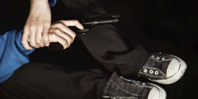 Teenage gangster holding