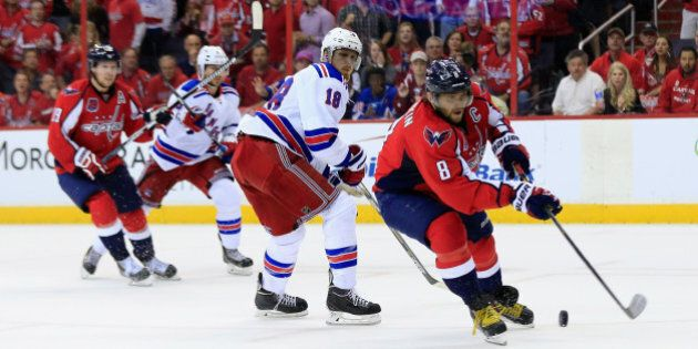 WASHINGTON, DC - MAY 10: Alex Ovechkin #8 of the Washington Capitals moves the puck in front of Marc...