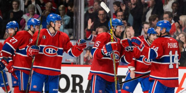 MONTREAL, QC - MAY 09:  The Montreal Canadiens celebrate their victory over the Tampa Bay Lightning in Game Five of the Eastern Conference Semifinals during the 2015 NHL Stanley Cup Playoffs at the Bell Centre on May 9, 2015 in Montreal, Quebec, Canada. The Canadiens defeated the Lightning 2-1.  The Lightning lead the series 3-2. (Photo by Minas Panagiotakis/Getty Images)