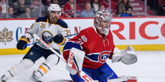 MONTREAL, QC - JANUARY 21:  Buffalo Sabres left wing Matt Moulson (26) gets into position behind Montreal Canadiens goalie Carey Price (31) during the third period of the NHL regular season game between the Buffalo Sabres and the Montreal Canadiens on January 21, 2017, at the Bell Centre in Montreal, QC (Photo by Vincent Ethier/Icon Sportswire via Getty Images)