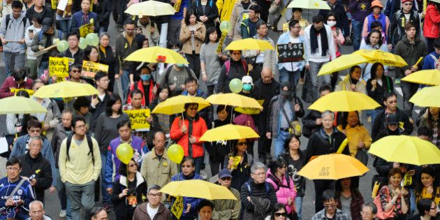 HONG KONG - FEBRUARY 01: Demonstrators march for democracy on February 1, 2015 in Hong Kong, Hong Kong....