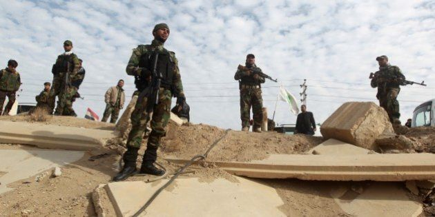 Volunteer Shiite fighters who support the government forces in the combat against the Islamic State (IS)...