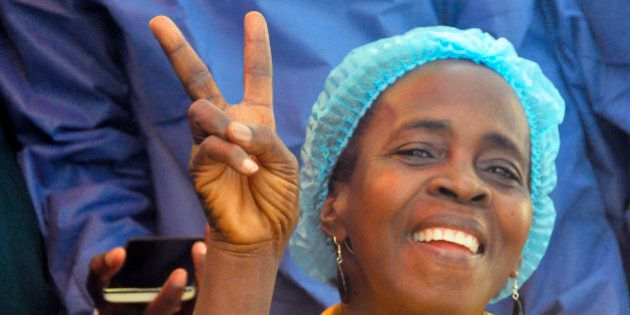 Ebola patient Beatrice Yardolo, celebrates with Ebola health workers as she leaves the Chinese Ebola...