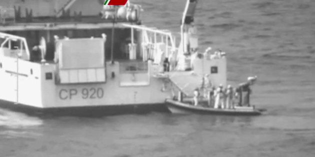 In this image taken from video made available by Guardia Costiera, an Italian coast Guard vessel during...