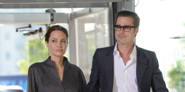 Angelina Jolie and Brad Pitt arriving at the final day of the End Sexual Violence in Conflict Conference,...