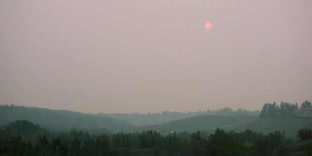 Smoke from the forest fires west of us settled deep into the city today. Looked like Blade Runner.
