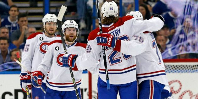 TAMPA, FL - MAY 7: Members of the Montreal Canadiens, including P.A. Parenteau #15, David Desharnais...